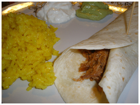 Pulled-pork tacos, or carnitas.