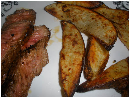 Flat Iron steak & oven-roasted potato wedges with cilantro-lime mayonnaise.