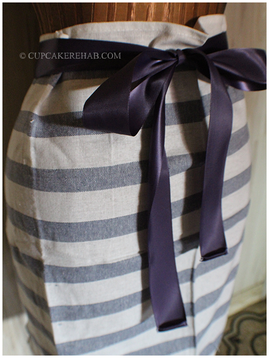 How to make your own tea towel half-apron using just ribbon & a towel. No sewing machine required!