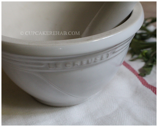 Le Creuset mortar & pestle used for bruising tarragon leaves for use in an easy homemade tarragon vinegar.