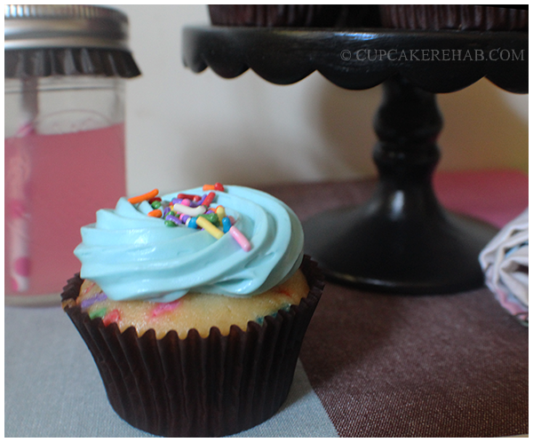 Happy 32nd birthday funfetti cupcakes with marshmallow frosting.
