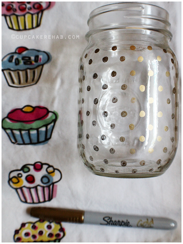 Cover a mason jar with gold polka dots using a Sharpie!