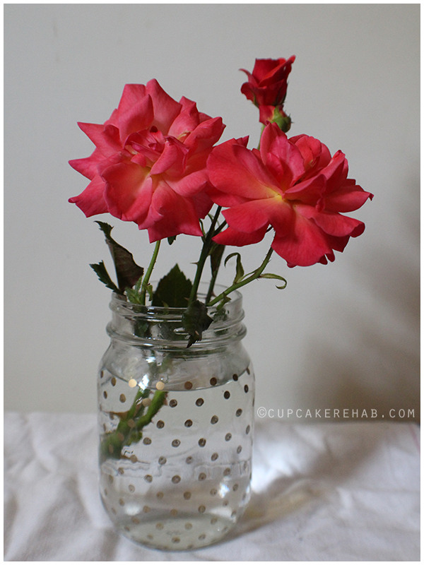 Roses in a gold-polka dotted mason jar.