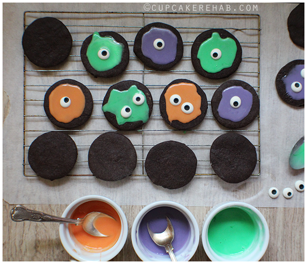 Soft, dark chocolate sugar cookies get magically transformed into melted monster cookies! And it's all with just a bit of icing & candy eyeballs.
