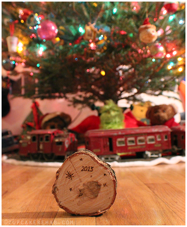 Cut the bottom off your (real) tree, then write or burn the date on it. Save them from year to year! Use them as coasters, ornaments, whatever. Just seal them with some acrylic spray sealant so the sap doesn't make them too sticky.