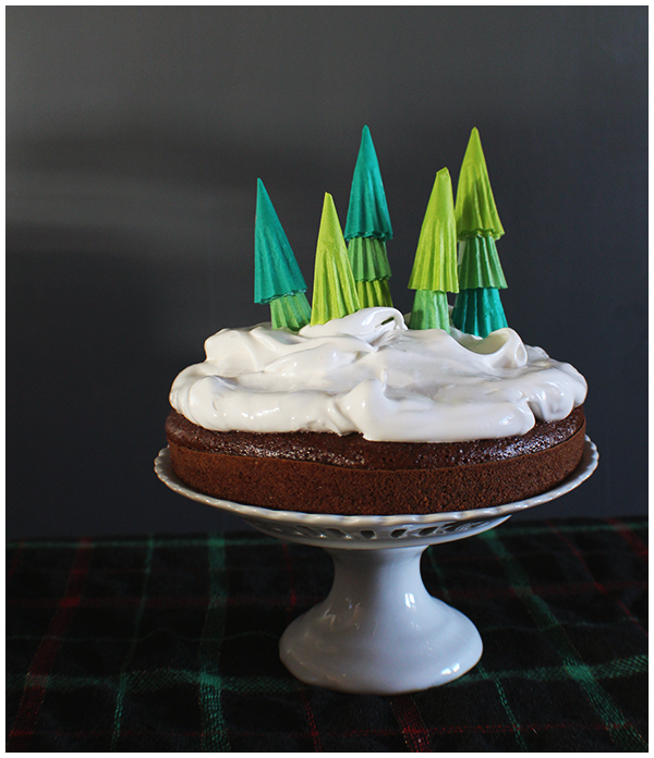 "Easy gingerbread cake with 7-minute frosting ""snow""... tastes just like marshmallow. Oh, and cupcake liner trees."