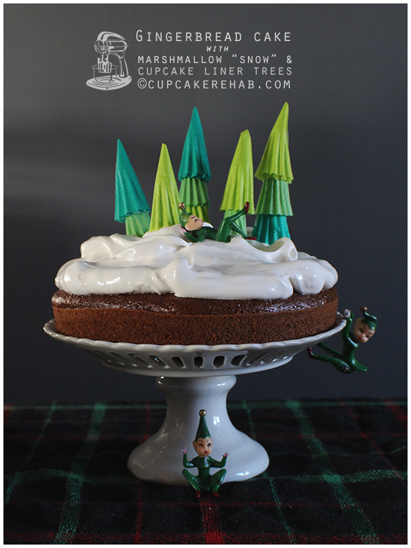 "Gingerbread cake with a marshmallow ""snow"" and paper cupcake liner trees. And elves!"