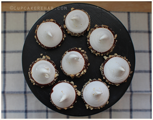 Vanilla meringues dipped in chocolate & rolled in graham cracker crumbs. S'mores meringues!