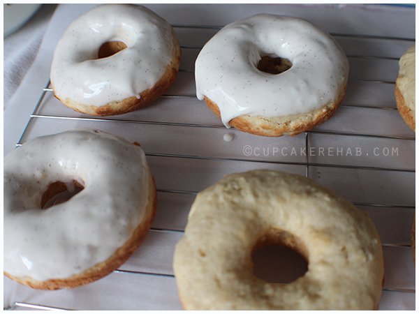 Baked brown butter donuts with a thick vanilla bean glaze.