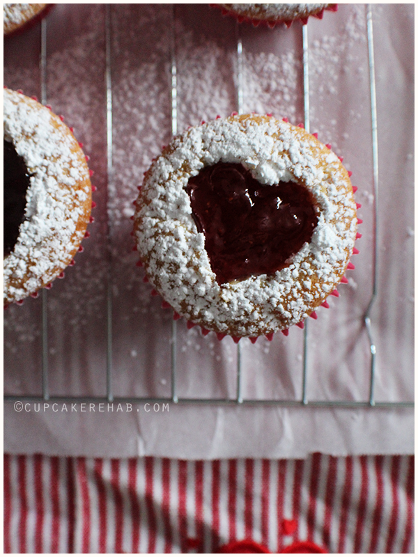 Linzer tart cupcakes filled with strawberry jam.