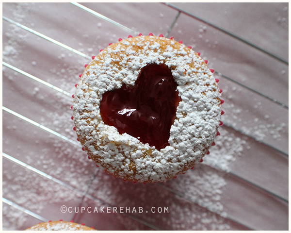 Linzer tart cupcakes: vanilla-lemon cupcakes with a strawberry jam center.