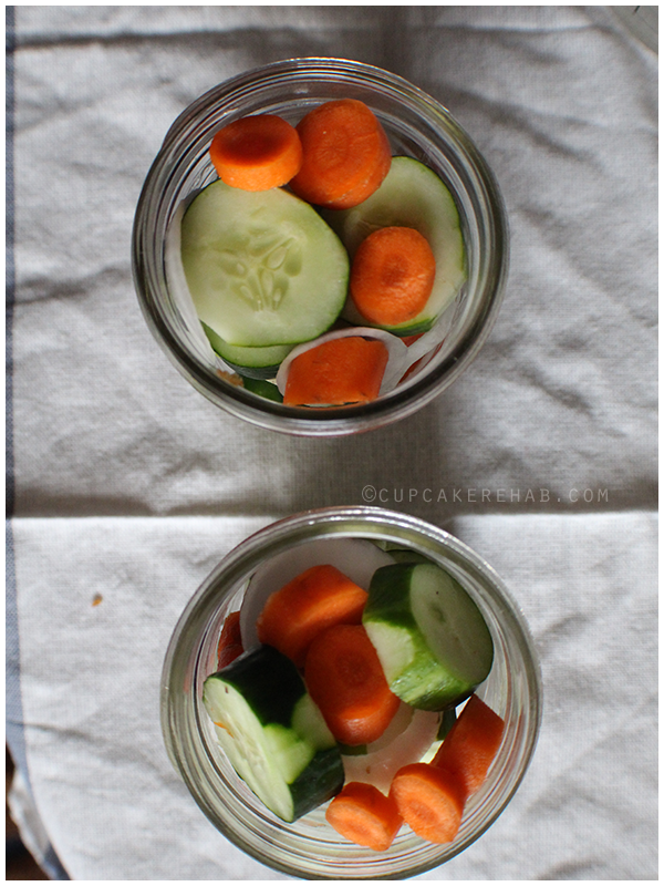 Quick cucumber pickles with carrots & onion.