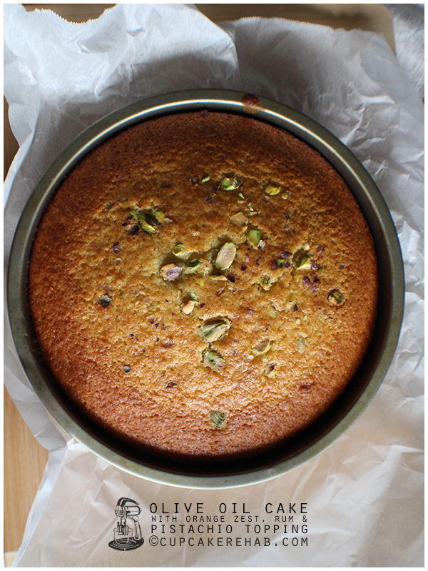 Olive oil cake with orange, rum & pistachios.