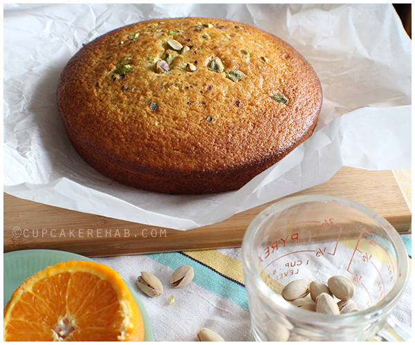 Easy olive oil cake with orange juice, orange zest, rum & a pistachio topping.