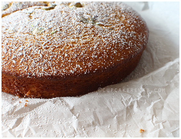 Olive oil cake with orange zest, rum & pistachios.