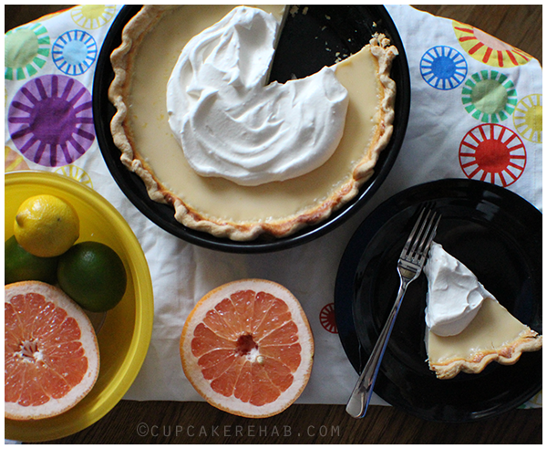 Grapefruit pie made with fresh Ruby Red grapefruit juice and topped with a grapefruit scented whipped cream.