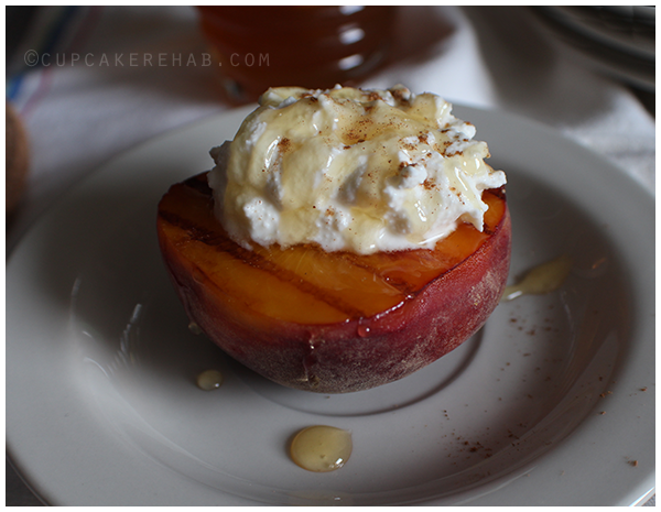 Grilled peach halves with a sweet ricotta cream & honey.