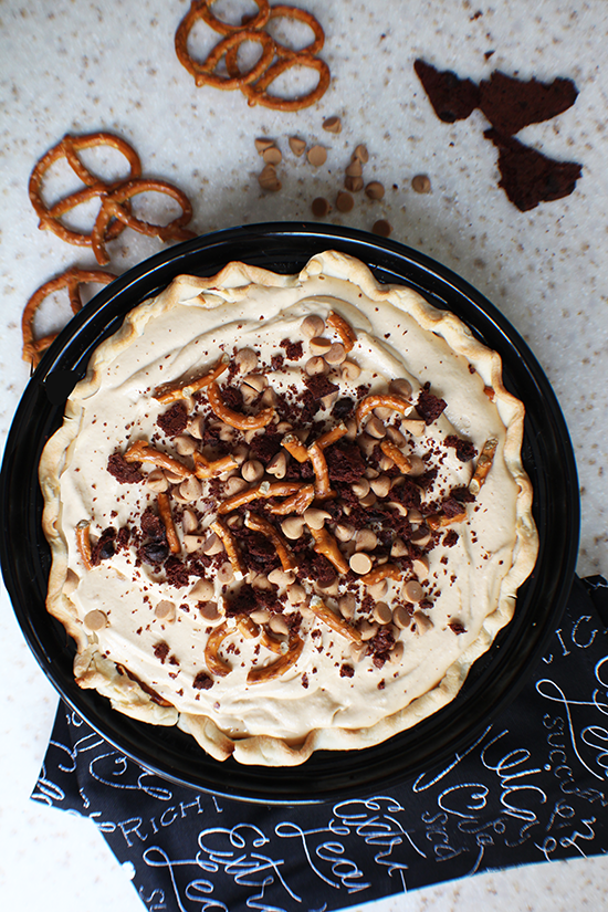 Peanut butter pie topped with pretzels, crumbled chocolate cookies & peanut butter chips.