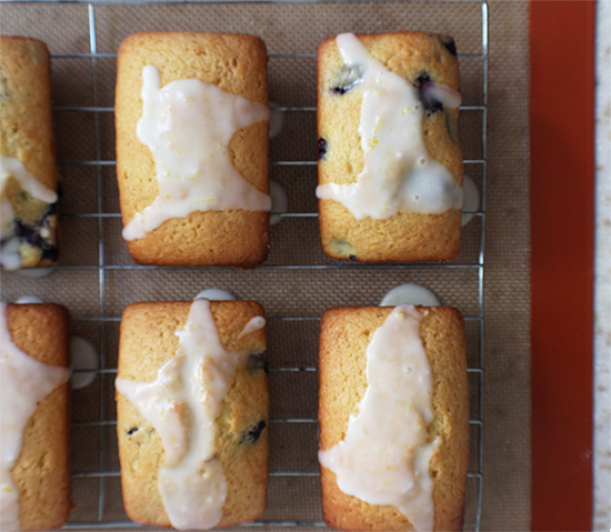 Lemon cakes, with or without blueberries, with a lemon glaze.