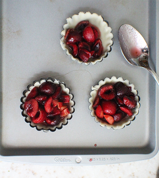 Mini cherry pies made with Pimm's liqueur.