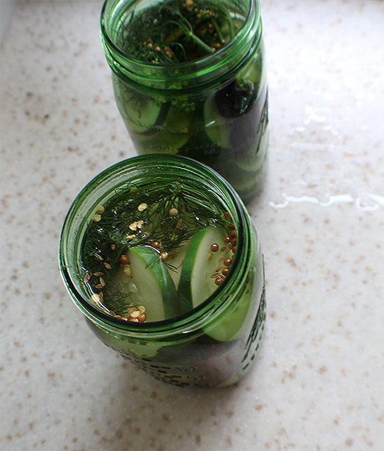 """Whiskey pickles in green """"Perfection"""" limited edition Ball jars."""