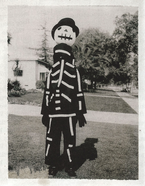 Tim Burton as a child in a costume his mother made for him for Halloween.