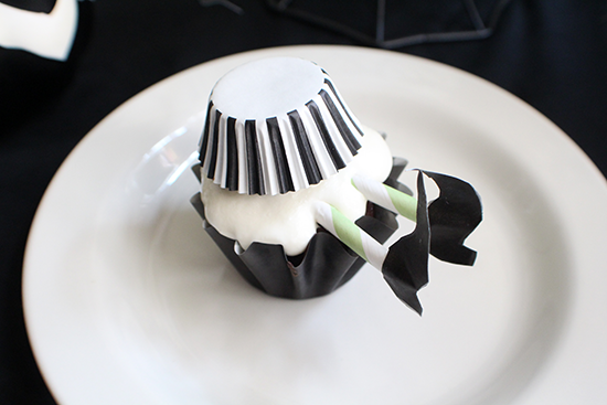 Wicked witch cupcakes made with paper straws.