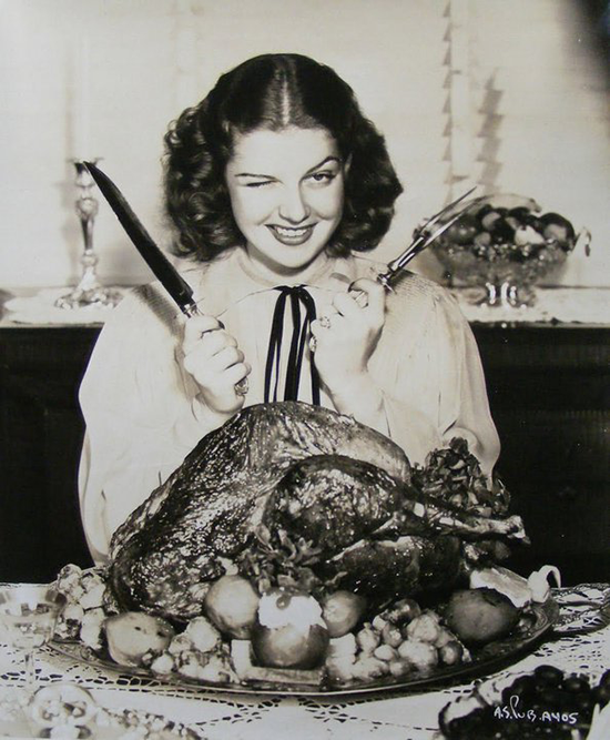 A young Rita Hayworth getting ready to dig in to that turkey...