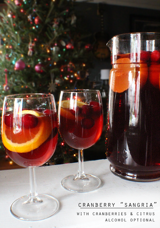 Cranberry sangria with orange & lemon slices, cranberries and cinnamon. Alcohol optional.