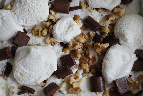 Rocky road brownies; covered with homemade marshmallows, chocolate chunks and walnuts.